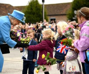 HRH The Queen at the unveiling of Queen Mother Square in Poundbury, accepting flowers from local children.