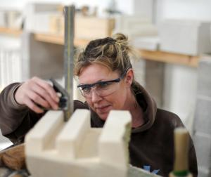 Stonemason working at the Stonemasonry school run by Weymouth College