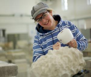 Stonemason working at the Stonemasonry school run by Weymouth College