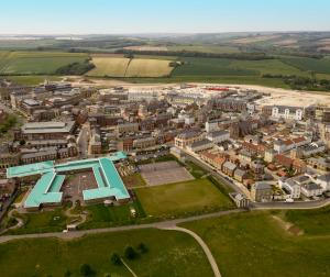 Aerial photograph of Damers First School on the left and the North East Quadrant to the west