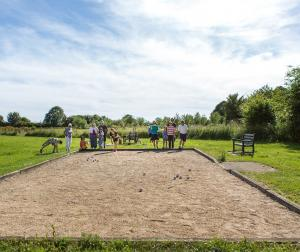 Families playing on the Pétanque area in Holmead Walk Gardens