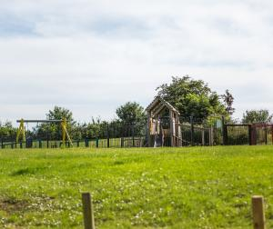 A children's play area in Holmead Walk